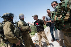 Palestinian protest and Israeli soldiers Royalty Free Stock Photos