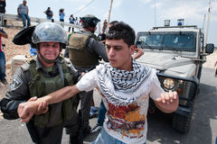Palestinian protest and Israeli soldiers Stock Image