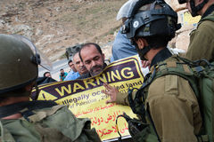 Palestinian protest and Israeli soldiers Stock Photos