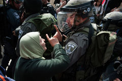 Palestinian protest and Israeli soldiers. A Palestinian woman confronts Israeli police during clashes on Nakba Day at Damascus Gate, East Jerusalem, May 15, 2013 royalty free stock image