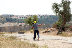 Palestinian Protester Shooting Rock at Protest Royalty Free Stock Images