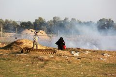 Palestinian protesters during clashes with Israeli forces near Israel-Gaza border royalty free stock photography