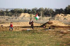 Palestinian protesters during clashes with Israeli forces near Israel-Gaza border stock image