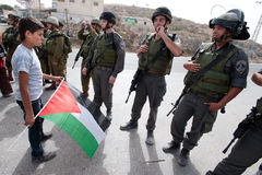 Palestinian Protesters Confront Israeli Soldiers. Al-MASARA, OCCUPIED PALESTINIAN TERRITORIES - OCTOBER 21: Palestinian activists confront Israeli soldiers to Royalty Free Stock Photography