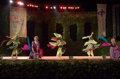 Swirling Folkloric dance ballerinas on scene Stock Photo