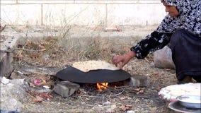 Palestinian woman baking bread 2 stock video