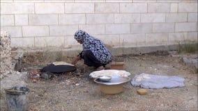 Palestinian woman baking bread 4 stock video