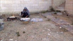 Palestinian woman baking bread 5 stock video footage