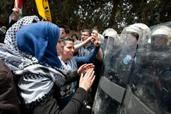 Palestinian women face riot police Royalty Free Stock Photos