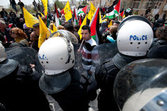 Palestinians face riot police Royalty Free Stock Photo
