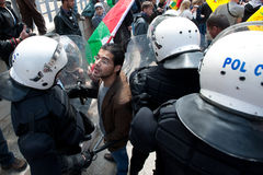 Palestinians face riot police Royalty Free Stock Photos