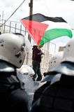 Palestinians face riot police Stock Images
