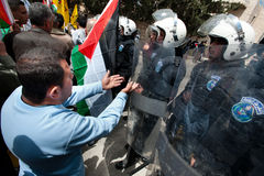 Palestinians face riot police Royalty Free Stock Images