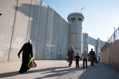 Palestinians at Israeli military checkpoint. BETHLEHEM, OCCUPIED PALESTINIAN TERRITORIES - AUGUST 17, 2012: Palestinian women pass through the Bethlehem Stock Photography