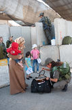 Palestinians at Israeli military checkpoint Royalty Free Stock Photography