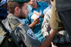 Palestinians at Israeli military checkpoint Stock Image