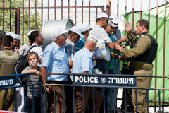 Palestinians at Israeli military checkpoint Royalty Free Stock Photos