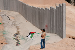 Palestinians and Israeli Separation Barrier Royalty Free Stock Image