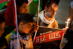 Palestinians and Israelis protest Gaza attacks. Palestinians gather in Bethlehem's Manger Square for a vigil mourning the victims of Israeli military strikes on royalty free stock photo