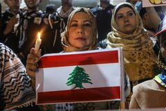 Palestinians light candles to show solidarity with the Lebanese people following Tuesday`s blast in Beirut`s port area