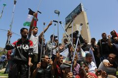 Palestinians participate in a march rejecting the policy of the Israeli annexation project in the West Bank and the Jordan Valley