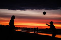 Sunset. Palestinians play soccer at sunset on the beach royalty free stock images