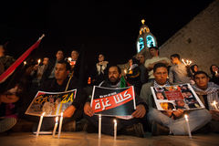 Palestinians protest Gaza attacks. Palestinians gather in front of the Church of the Nativity in Bethlehem's Manger Square for a vigil mourning the victims of stock photo