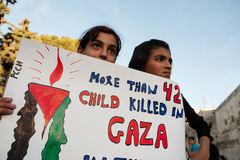 Palestinians protest Gaza attacks. Palestinian children at a Bethlehem, West Bank, protest carry a sign reading More than 42 child killed in Gaza, November 29 royalty free stock photos