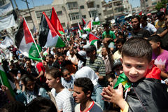 Palestinians rally to commemorate Nakba Day. RAMALLAH, PALESTINIAN TERRITORIES - MAY 15: A crowd of flag-waving Palestinians fills the streets of Ramallah on Royalty Free Stock Images