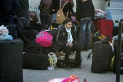 Egyptian authorities reopen the sole passenger crossing between Gaza and Egypt in both directions today. Palestinians wait to leave Gaza through Rafah border stock photo