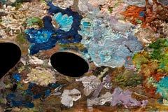 Paleta con las pinturas de aceite Imagen de archivo