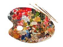 Paleta da arte com gotas da pintura e de uma escova Fotografia de Stock Royalty Free