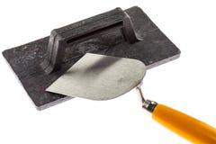 Paleta de enyesado y máquina de alisar o cepillar de la construcción imágenes de archivo libres de regalías
