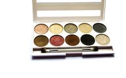 Paleta de la sombra para el maquillaje con el espejo fotografía de archivo