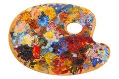 Paleta de madera del arte con las pinturas de aceite y cepillos aislados en whi Fotografía de archivo libre de regalías