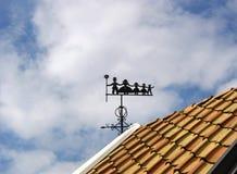 Paleta de viento con barrido de chimenea, la madre y tres niños Imagenes de archivo