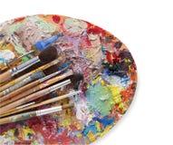 Paleta del arte con los movimientos coloridos de la pintura, aislados Foto de archivo libre de regalías