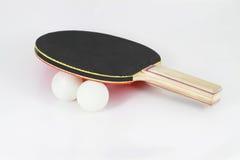 Paleta del ping-pong con las bolas Imagenes de archivo