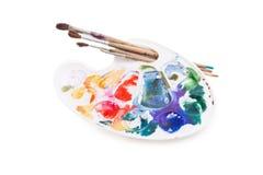 A paleta do artista usado pesado com escovas Imagens de Stock