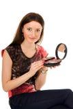 Paleta do cosmético da terra arrendada da mulher nova Fotos de Stock