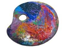 Paleta do pintor colorido isolada no branco Fotos de Stock