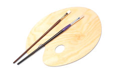Paleta e escovas de madeira da pintura Foto de Stock