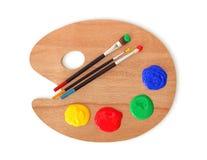 Paleta e escovas do artista Imagens de Stock