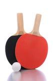 Paletas y bola del ping-pong Foto de archivo