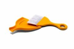 Paletta per la spazzatura arancio Fotografia Stock Libera da Diritti
