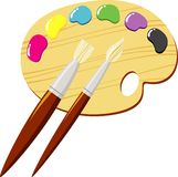 Palette. Of paints and brushes royalty free illustration