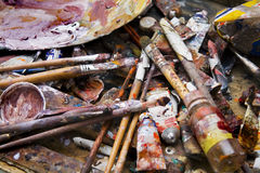 Palette. Old palette with brushes and paint tubes royalty free stock photo