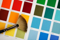 Palette. Brush on a palette of colours royalty free stock image