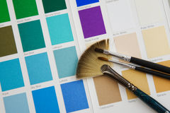 Palette. Brush on a palette of colours Royalty Free Stock Photo