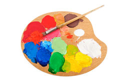 Palette. Paint brush on the palette with bright acrylic color Stock Image
